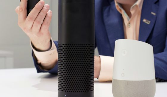 In this June 14, 2018, photo, an Amazon Echo, center, and a Google Home, right, are displayed in New York. Google contractors are listening to some recordings of people talking to Assistant, either on their phone or through smart speakers such as the Google Home. The company says some of its Dutch language recordings were leaked and that it is investigating. (AP Photo/Mark Lennihan, File)