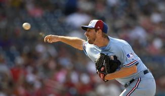 Washington Nationals starting pitcher Max Scherzer delivers a pitch during a baseball game against the Kansas City Royals, Saturday, July 6, 2019, in Washington. The Nationals are paying tribute to the Montreal Expos in today's game by wearing throwback uniforms. (AP Photo/Nick Wass) ** FILE **