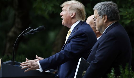 President Donald Trump is joined by Commerce Secretary Wilbur Ross and Attorney General William Barr, right, as he speaks in the Rose Garden at the White House in Washington, Thursday, July 11, 2019. (AP Photo/Alex Brandon)