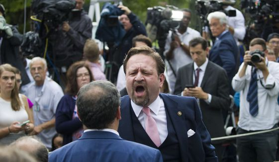 Radio host Sebastian Gorka, yells at Playboy reporter Brian Karem after President Donald Trump spoke about the 2020 census in the Rose Garden of the White House, Thursday, July 11, 2019, in Washington. (AP Photo/Alex Brandon)