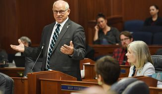 State Sen. John. Coghill, a Fairbanks Republican, speaks during a joint session of the Alaska Legislature Thursday, July 11, 2019, in Juneau, Alaska. Lawmakers are meeting for a second day to consider overriding Gov. Mike Dunleavy's budget vetoes, but still don't have the needed 45 votes as about a third of lawmakers continue to meet in Wasilla instead of Juneau. (Michael Penn/The Juneau Empire via AP)