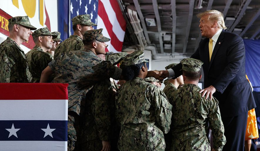President Donald Trump greets troops after speaking at a Memorial Day event aboard the USS Wasp, Tuesday, May 28, 2019, in Yokosuka, Japan. (AP Photo/Evan Vucci) ** FILE **