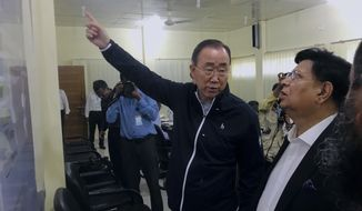 In this Wednesday, July 10, 2019 photo, former U.N. Secretary-General Ban Ki-moon, center, gestures as he is briefed by Bangladesh foreign minister A.K.Abdul Momen, right during avist to the Kutupalong Rohingya refugees camp in the southern coastal district of Cox's Bazar, Bangladesh. Ban has expressed concern that monsoon floods could threaten the lives of Rohingya refugees in sprawling camps in Bangladesh. (AP Photo/ Al-emrun Garjon)