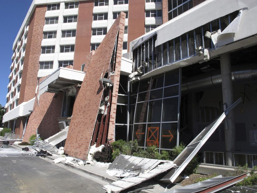 Structural engineers with experience responding to earthquakes and natural disasters are helping experts at the University of Nevada, Reno with efforts to rebuild this dormitory, Thursday, July 11, 2019, in Reno, Nev., where a natural gas explosion blew out walls and windows last week. School officials gave members of the media their first up-close look at the exterior and interior damage on Thursday. Only eight people suffered minor injuries in the July 5 blast. (AP Photo/Scott Sonner)