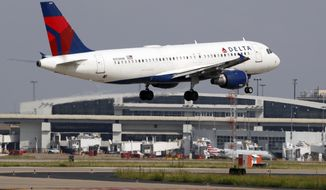 FILE - In this June 24, 2019, file photo a Delta Air Lines aircraft makes its approach at Dallas-Fort Worth International Airport in Grapevine, Texas. Delta Air Lines, Inc. reports earnings Wednesday, July 10. (AP Photo/Tony Gutierrez, File)