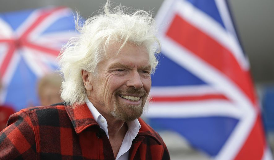 FILE - In this Monday, March 27, 2017 file photo, Richard Branson, founder of Virgin Atlantic and the Virgin Group, smiles at Seattle-Tacoma International Airport in Seattle. Branson has warned that a no-deal Brexit will force the company to invest less in Britain because of pressures on the pound. Branson has told the BBC on Thursday, July 11, 2019 that if the U.K. leaves the European Union without a deal, it will force his company to shift investment because its costs are in dollars. (AP Photo/Ted S. Warren, file)