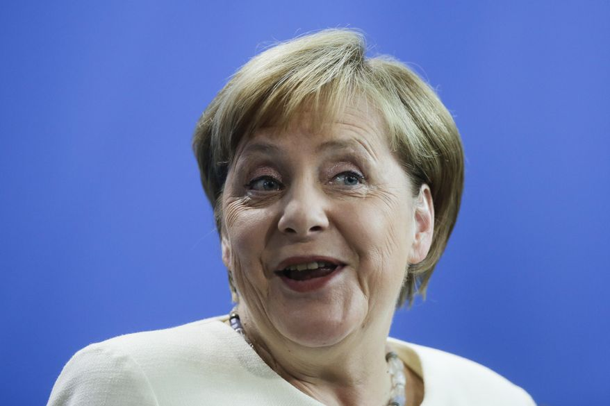 German Chancellor Angela Merkel reacts during a news conference with Danish Prime Minister Mette Frederiksen after a meeting at the chancellery in Berlin, Thursday, July 11, 2019. (AP Photo/Markus Schreiber)