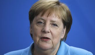 German Chancellor Angela Merkel answers to questions during a news conference following a meeting with the Prime Minister of Finland Antti Rinne at the chancellery in Berlin, Wednesday, July 10, 2019. (AP Photo/Markus Schreiber)
