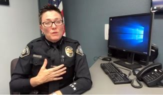 In this photo from video provided by the San Luis Obispo, Calif., Police Department and posted on their Facebook page Wednesday, July 10, 2019, Chief Deanna Cantrell says she left her gun in a restaurant restroom and it was immediately stolen. Cantrell says within minutes she realized what she'd done and returned to the restroom, but the firearm was gone. Security video shows a man entering and quickly leaving the restroom. She says her actions were irresponsible and dangerous and she expects to be held accountable. (San Luis Obispo Police Department via AP)