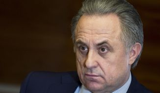 FILE - In this Friday, Feb. 2, 2018 file photo, Russian Deputy Prime Minister Vitaly Mutko speaks during an interview with the Associated Press in Moscow, Russia. Mutko, who was Russia's Sports Minister during the doping-tainted Winter Olympics in Sochi, has won an appeal against his lifetime ban from the games. (AP Photo/Pavel Golovkin, File)