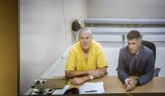 Former Washington State quarterback and Superbowl MVP Mark Rypien appears alongside defense attorney Chris Bugbee via video conference for a hearing presided over by commissioner Kristin O'Sullivan on Monday, July 1, 2019, in Spokane, Wash. Rypien was arrested yesterday for alleged fourth degree domestic violence against his wife, and is slated for release today without a no contact order. (Libby Kamrowski/The Spokesman-Review via AP)