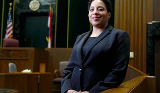 FILE - In this May 5, 2017, file photo, St. Louis Circuit Attorney Kim Gardner poses in St. Louis. A grand jury that indicted the man hired by Gardner to investigate former Missouri Gov. Eric Greitens has disbanded, but Gardner may not be clear of scrutiny. The grand jury's term expired Monday, July 8, 2019 without a second indictment. The St. Louis Post-Dispatch, citing unnamed sources, reports that an investigation of Gardner continues and a special prosecutor may request another grand jury. (AP Photo/Jeff Roberson, File)