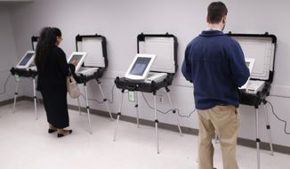 In this Dec. 4, 2018, file photo, locals cast their vote in Georgia's runoff election at the Lake Park Community Center in Athens, Ga. (Joshua L. Jones/Athens Banner-Herald via AP, File)