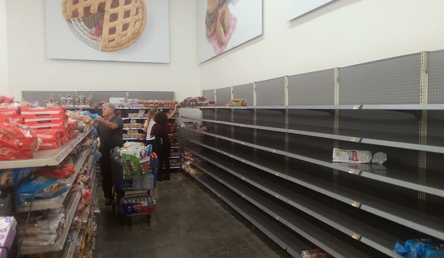 The bread section Friday afternoon at a Wal-Mart outside New Orleans has been picked over as shoppers swarm the giant retailer for supplies while bracing for Tropical Storm Barry. The storm, predicted to reach hurricane strength before making landfall, is scheduled to hit the Louisiana coast near Morgan City later Friday. (The Washington Times/James Varney)
