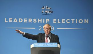 Conservative Party leadership candidate Boris Johnson, gestures, during a Conservative Party leadership hustings in Cheltenham, England, Friday July 12, 2019. (Jacob King/PA via AP)