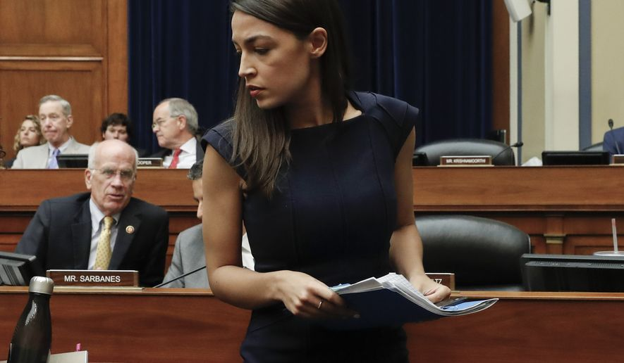 Rep. Alexandria Ocasio-Cortez, D-NY., leaves the hearing room after testifying before the House Oversight Committee hearing on family separation and detention centers, Friday, July 12, 2019 on Capitol Hill in Washington. (AP Photo/Pablo Martinez Monsivais)