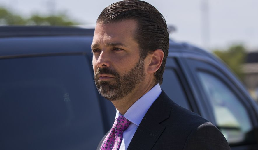 Donald Trump Jr., the son of President Donald Trump, steps off Air Force One with President Donald Trump as they arrive at General Mitchell International Airport, Friday, July 12, 2019, in Milwaukee. (AP Photo/Alex Brandon)