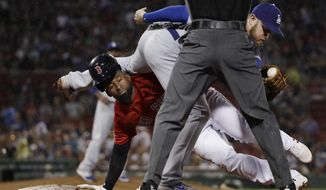 Boston Red Sox's Jackie Bradley Jr. , left, gets back safely to first base as Los Angeles Dodgers first baseman Max Muncy hangs on to the ball after a pickoff attempt during the seventh inning of a baseball game at Fenway Park, Friday, July 12, 2019, in Boston. (AP Photo/Elise Amendola)