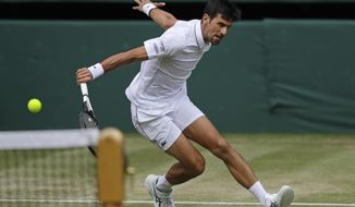 Serbia's Novak Djokovic returns to Spain's Roberto Bautista Agut in a Men's singles semifinal match on day eleven of the Wimbledon Tennis Championships in London, Friday, July 12, 2019. (AP Photo/Kirsty Wigglesworth)