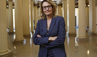 Marybel Batjer, who has been appointed to head the California Public Utilities Commission, poses in Sacramento, Calif., Friday, July 12, 2019. Gov. Gavin Newsom announced, Friday, he is appointing Batjer who is currently the secretary of the California Government Operations Agency, will succeed current PUC President Michael Picker. (AP Photo/Rich Pedroncelli)