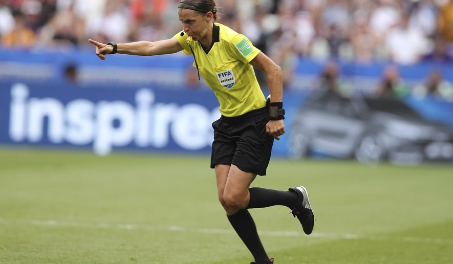 Referee Stephanie Frappart points to the penalty spot after checking the VAR during the Women's World Cup final soccer match between US and The Netherlands at the Stade de Lyon in Decines, outside Lyon, France, Sunday, July 7, 2019. (AP Photo/Francisco Seco)