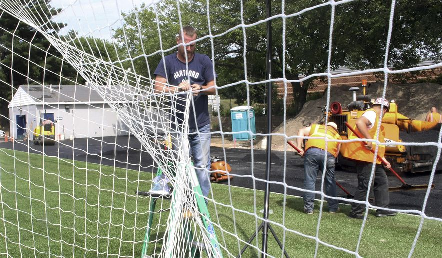 Workers complete the $14 million renovation project at Dillon Stadium on Thursday, July 11, 2019, in Hartford, Conn. The 84-year-old stadium reopens Saturday as home to Hartford Athletic, the city's new profession soccer team. (AP Photo/Pat Eaton-Robb)