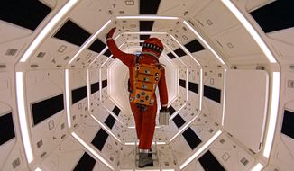 """This image released by Warner Bros. Pictures shows Keir Dullea in a scene from the 1968 film, """"2001: A Space Odyssey."""" Space exploration was then an exciting possibility, but one far from realization. Stanley Kubrick and science-fiction author Arthur C. Clarke, convinced the moon was only the start, began to toil on a script together. It would be five years before astronauts landed on the moon, on July 20, 1969. Kubrick took flight sooner. """"2001: A Space Odyssey"""" opened in theaters April 3, 1968. (Warner Bros. via AP)"""