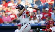 Washington Nationals' Ryan Zimmerman, left, follows through after hitting an RBI-sacrifice fly off Philadelphia Phillies starting pitcher Nick Pivetta during the third inning of a baseball game, Friday, July 12, 2019, in Philadelphia. Phillies catcher Andrew Knapp, right, looks on. (AP Photo/Matt Slocum) **FILE**