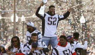 """FILE - In this Feb. 5, 2019, file photo, New England Patriots' Elandon Roberts (52) rides a duck boat during the Patriots parade through downtown Boston to celebrate their win over the Los Angeles Rams in NFL Super Bowl 53. Roberts is condemning his treatment by a Texas sheriff's deputy who referred to him as a """"big black man"""" during a March traffic stop. Roberts in a statement to USA Today says """"these types of things are happening all too often to African-Americans."""" The linebacker was returning to his home southwest of Houston and was followed by the Fort Bend County deputy before the deputy initiated the stop as Roberts drove into his driveway. (AP Photo/Michael Dwyer, File)"""