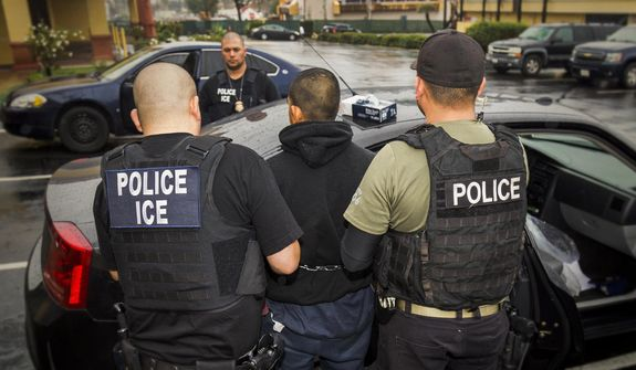 In this Tuesday, Feb. 7, 2017, photo released by U.S. Immigration and Customs Enforcement, foreign nationals are arrested during a targeted enforcement operation conducted by U.S. Immigration and Customs Enforcement (ICE) aimed at immigration fugitives, re-entrants and at-large criminal aliens in Los Angeles. (Charles Reed/U.S. Immigration and Customs Enforcement via AP) **FILE**