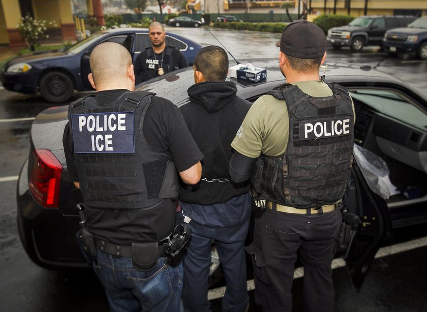 In this Tuesday, Feb. 7, 2017, file photo released by U.S. Immigration and Customs Enforcement, foreign nationals are arrested during a targeted enforcement operation conducted by U.S. Immigration and Customs Enforcement (ICE) aimed at immigration fugitives, re-entrants and at-large criminal aliens in Los Angeles. (Charles Reed/U.S. Immigration and Customs Enforcement via AP) ** FILE **