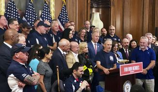 Entertainer and activist Jon Stewart, speaks at a news conference on behalf of 9/11 victims and families, Friday, July 12, 2019, at the Capitol in Washington. The House is expected to approve a bill Friday ensuring that a victims' compensation fund for the Sept. 11 attacks never runs out of money. (AP Photo/Matthew Daly)