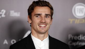 """FILE - In this Monday, Dec.3, 2018 file photo, Atletico Madrid's Antoine Griezmann arrives for the Golden Ball, """"Ballon d'Or"""" award ceremony at the Grand Palais in Paris, France. Barcelona says France forward Antoine Griezmann has agreed to join the Spanish champions after it paid his buyout clause to free him from rival Atletico Madrid. Barcelona says on Friday, July 12, 2019 that Griezmann will strengthen an attack led by Lionel Messi and Luis Suarez after signing a five-year contract. (AP Photo/Christophe Ena, file)"""