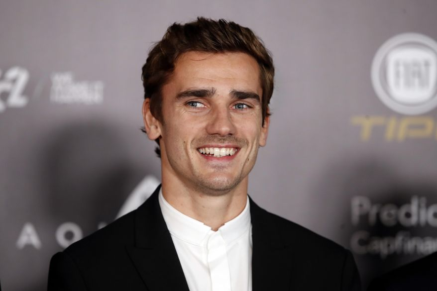 "FILE - In this Monday, Dec.3, 2018 file photo, Atletico Madrid's Antoine Griezmann arrives for the Golden Ball, ""Ballon d'Or"" award ceremony at the Grand Palais in Paris, France. Barcelona says France forward Antoine Griezmann has agreed to join the Spanish champions after it paid his buyout clause to free him from rival Atletico Madrid. Barcelona says on Friday, July 12, 2019 that Griezmann will strengthen an attack led by Lionel Messi and Luis Suarez after signing a five-year contract. (AP Photo/Christophe Ena, file)"