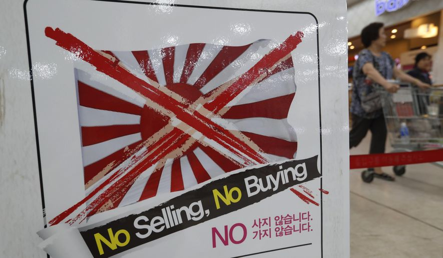 "A notice campaigning for a boycott of Japanese-made products is displayed at a store in Seoul, South Korea, Friday, July 12, 2019. South Korea said Friday it wants an investigation by the United Nations or another international body as it continues to reject Japanese claims that Seoul could not be trusted to faithfully implement sanctions against North Korea. The signs read: ""We don't sell Japanese products."" (AP Photo/Ahn Young-joon)"