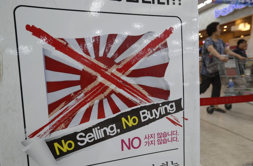 """A notice campaigning for a boycott of Japanese-made products is displayed at a store in Seoul, South Korea, Friday, July 12, 2019. South Korea said Friday it wants an investigation by the United Nations or another international body as it continues to reject Japanese claims that Seoul could not be trusted to faithfully implement sanctions against North Korea. The signs read: """"We don't sell Japanese products."""" (AP Photo/Ahn Young-joon)"""