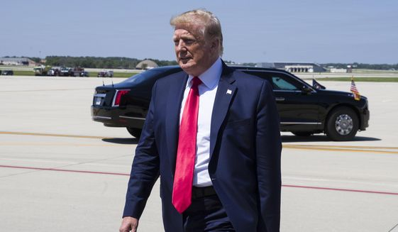 President Donald Trump walks to greet supporters as he arrives at General Mitchell International Airport, Friday, July 12, 2019, in Milwaukee. (AP Photo/Alex Brandon)