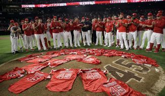 Members of the Los Angeles Angels place their jerseys with No. 45 in honor of pitcher Tyler Skaggs on the mound after a combined no-hitter against the Seattle Mariners during a baseball game Friday, July 12, 2019, in Anaheim, Calif. The Angels won 13-0. (AP Photo/Marcio Jose Sanchez) ** FILE **