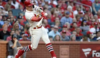 St. Louis Cardinals' Tyler O'Neill hits a two-run home run during the third inning of the team's baseball game against the Arizona Diamondbacks on Saturday, July 13, 2019, in St. Louis. (AP Photo/Jeff Roberson)