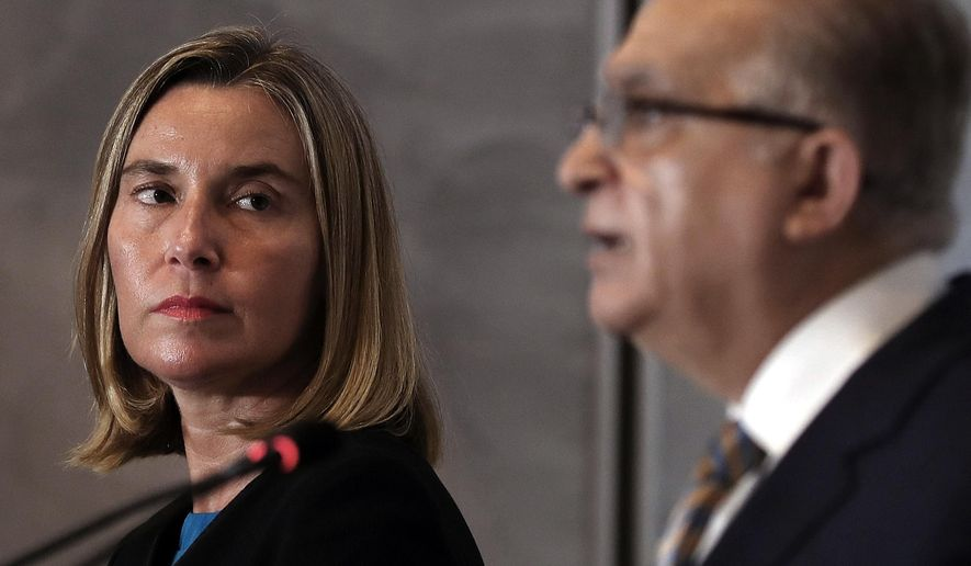 Iraqi Foreign Minister Mohamed Alhakim, right, holds a press conference with visiting European Union foreign policy chief Federica Mogherini after their meeting at the Ministry of Foreign Affairs in Baghdad, Iraq, Saturday, July 13, 2019. (AP Photo/Hadi Mizban)