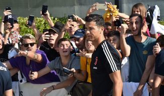 Juventus' Cristiano Ronaldo arrives at the team's medical center before taking part to a training session, in Turin, Italy, Saturday, July 13, 2019. (Alessandro Di Marco/ANSA via AP)