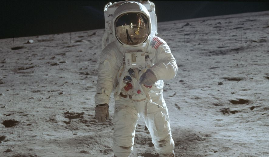 In this July 20, 1969, photo made available by NASA, astronaut Buzz Aldrin, lunar module pilot, walks on the surface of the moon during the Apollo 11 extravehicular activity. (Neil Armstrong/NASA via AP)