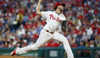 Philadelphia Phillies' Aaron Nola pitches during the fourth inning of a baseball game against the Washington Nationals, Saturday, July 13, 2019, in Philadelphia. (AP Photo/Matt Slocum)