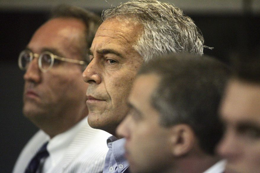 In this July 30, 2008, file photo, Jeffrey Epstein, center, appears in court in West Palm Beach, Fla. (Uma Sanghvi/Palm Beach Post via AP, File)