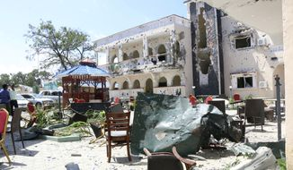 A view of Asasey Hotel after an attack, in Kismayo, Somalia, Saturday, July 13, 2019. At least 10 people, including two journalists, were killed in an extremist attack Friday on a hotel in the port city of Kismayo, a Somali official said. The attack started with a suicide car bomb blast and then gunmen stormed into the hotel. (AP Photo)