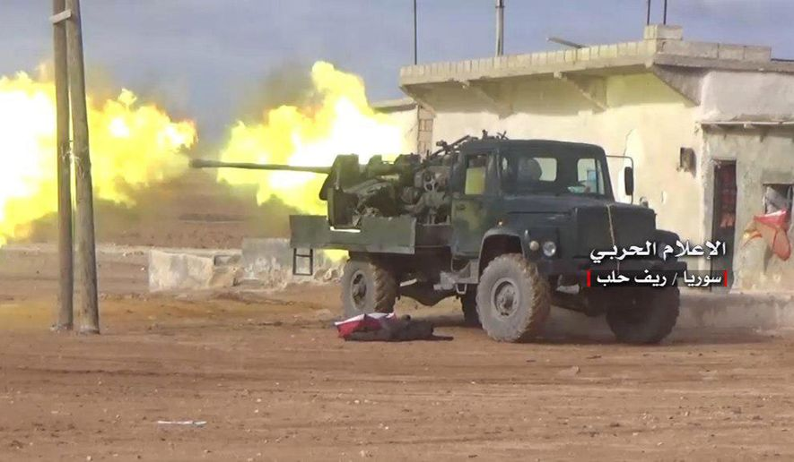 In this Saturday, Jan. 20, 2018, file photo, provided by the government-controlled Syrian Central Military Media, shows Syrian government forces firing their weapon during a battle against the Syrian opposition fighters, in the southern Aleppo countryside, Syria. In two months of intensive airstrikes and bombardments on the rebel-controlled province of Idlib, Syrian government forces and their Russian allies have failed to make progress against battle-hardened insurgents. (Syrian Central Military Media, via AP, File)