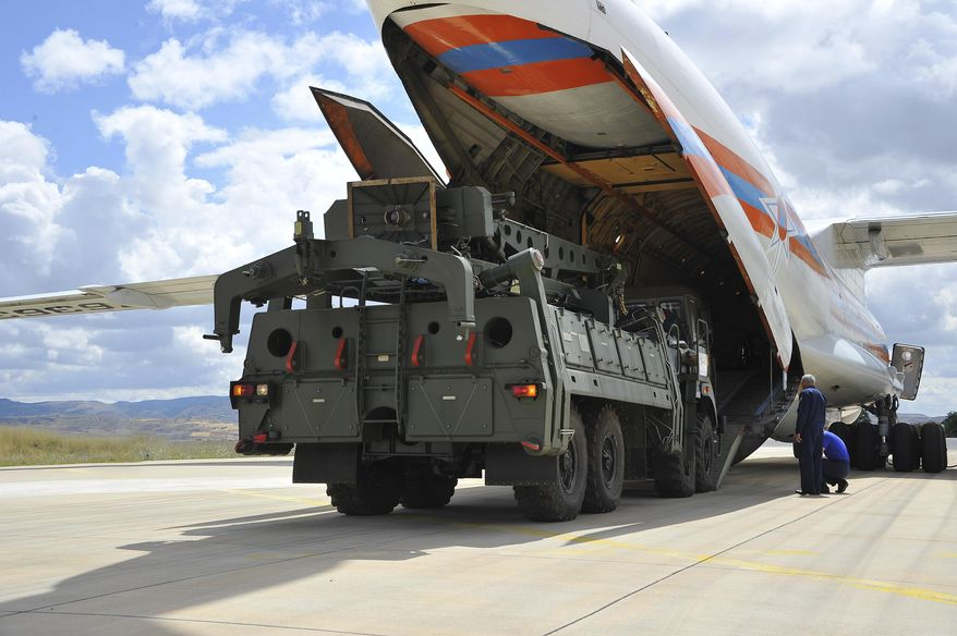 Military vehicles and equipment, parts of the S-400 air defense systems, are unloaded from a Russian transport aircraft, at Murted military airport in Ankara, Turkey, Friday, July 12, 2019. (Turkish Defence Ministry via AP, Pool) ** FILE **