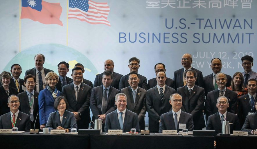 Taiwan President Tsai Ing-we, seated second from left, pose with participants at the U.S. Taiwan Business Summit, Friday July 12, 2019, in New York. (AP Photo/Bebeto Matthews)
