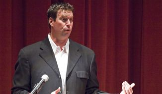 """In this Oct. 13, 2011, file photo, former Washington State quarterback Ryan Leaf speaks about his first book, """"596 Switch,"""" in Pullman, Wash. Leaf has been hired by ESPN to be a college football analyst, another step in the remarkable comeback of the former Washington State star who has battled drug addiction and served time in prison. (Dean Hare/The Moscow-Pullman Daily News via AP) ** FILE **"""
