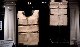 The life jackets of Madeline Astor and Laura Mabel Francatelli are displayed at the Titanic Museum in Pigeon Forge, Tenn. on Tuesday, July 9, 2019. The museum is showing six of the 12 known remaining life jackets from ship, including at least one worn by a survivor that's never been shown. (Calvin Mattheis/Knoxville News Sentinel via AP)